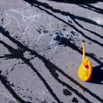 """Orange watering can on hot asphalt"" by kavolis"