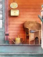 Porch With Brass Watering Can