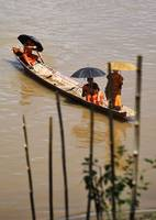 Monks Cross the Mekong River