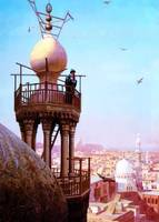 A muezzin calling from the top of a minaret
