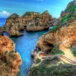 """""""Grottos at Ponta Piedade"""" by manateevoyager"""