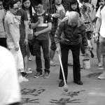 """the caligrapher draws a crowd"" by michael_davisburchat"