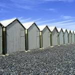 """Row of beach huts"" by simonevanbergen"