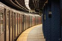 Train leaving empty New York City Subway Station