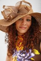 Frizzy girl in the hat wide-brimmed