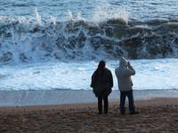 Wave watching couple