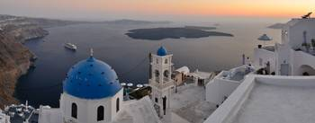 Firostefani's panorama in Santorini at sunset