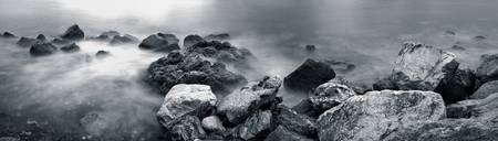 Panoramic photo of coastal rocks in the water