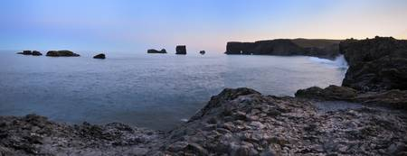Panoramic photo of Vik at sunset (midnight sun)