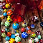 """Red jar with marbles"" by photogarry"