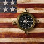 """Compass on wooden folk art flag"" by photogarry"