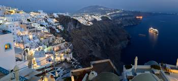 Panoramic photo of Fira at dusk, Santorini, Greece