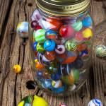 """Jar of marbles with shooter"" by photogarry"
