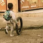 """Kid pushing tire"" by esc"