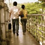 """Couple crossing bridge"" by esc"