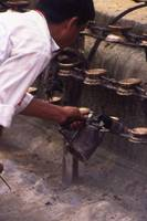 Cleaning candle holders, Kathmandu