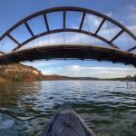 """Kayaking under Pennybacker Bridge - Austin, Texas"" by RobGreebonPhotography"