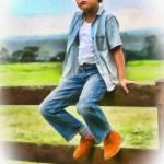 Boy Sitting on Fence 001