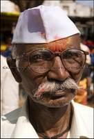 Gandhi cap and moustache