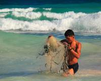 Fisherman with Net in Tulum Mexico