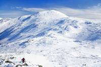 Hiker and Mount Washington in Winter