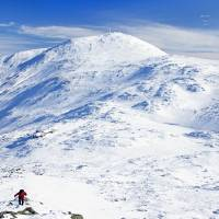 Hiker and Mount Washington in Winter Art Prints & Posters by Tim Seaver