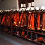 """Firefighter Uniforms Lined Up at Fire Station, Pen"" by nawfalnur"