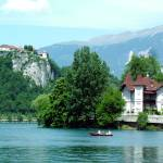 """Rowing on Lake Bled"" by DonnaCorless"