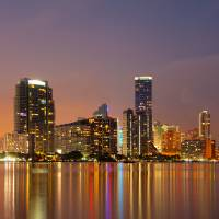 Miami skyline at night Art Prints & Posters by Carsten Reisinger
