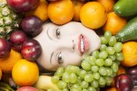 Beautiful woman's face sourrounded by fruit.