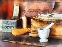 Mortar and Pestle and Box of Cocoa