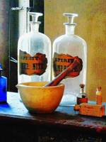 Mortar and Pestle With Bottles