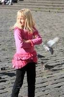 Girl Watching Pigeons Fly