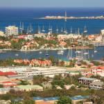 """Simpson Bay waterfront vista, St. Maarten"" by RoupenBaker"
