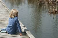 Young Blond girl looking across a marsh