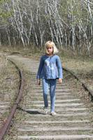 Young Blond Girl on Railway Tracks