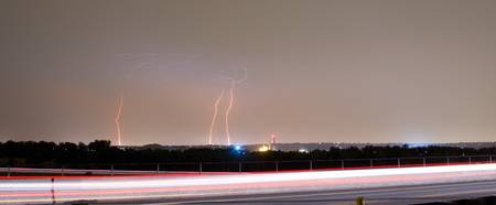 Lightning Strikes Next to Highway Panorama