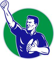 rugby player with ball pumping fist