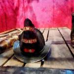 """Fire Helmet in Fire Truck"" by susansartgallery"