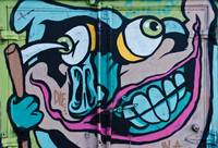 Poke in the Eye Graffiti detail on the truck door.