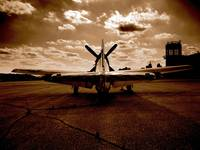 Sepia World War Two Fighter Plane on runway