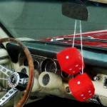 """Red Fuzzy Dice In Converible"" by susansartgallery"