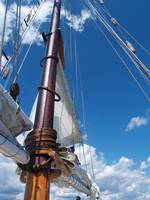 Sailboat Mast Stands Tall, Blue Sky Above