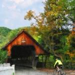 """Bicyclist At Middle Bridge Woodstock VT"" by susansartgallery"