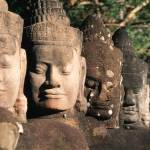 """Stonefaced guards of Angkor Thom"" by johnmacdonald"