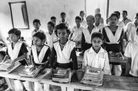 Bangladeshi tribal kids having a lesson at school