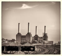 Battersea Power Station with train tracks Photogra