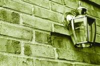 Duotone Brick Wall with Brass Lamp