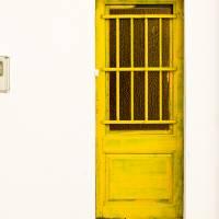 Yellow Door Of Catalunya Spain Art Prints & Posters by Calvin Hanson