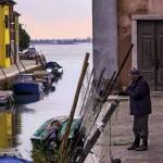 """2013-08-02-Burano fisherman mending nets"" by FoxtowerPhotography"